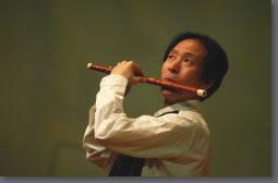 笛奏者:王明君